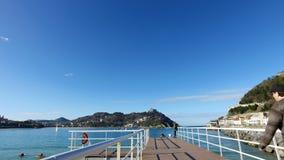 Donostia圣塞巴斯蒂安,巴斯克地区,城市,西班牙 La外耳海滩,从码头的全景 图库摄影