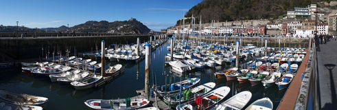 Donostia, San Sebastian, Bay of Biscay, Basque Country, Spain, Europe. Basque Country, Spain, 28/01/2017: boats in the port and view of the skyline on the stock photos