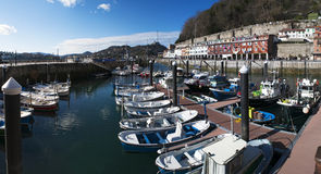 Donostia, San Sebastian, Bay of Biscay, Basque Country, Spain, Europe. Basque Country, Spain, 28/01/2017: boats in the port and view of the skyline on the stock photography