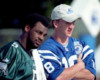Donovan McNabb and Peyton Manning, 2001 QB Challenge. Donovan McNabb and Peyton Manning at the 2001 NFL QB Challenge. Image taken from color slide royalty free stock images