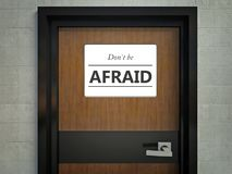 Dont be afraid sign hanging on a office door Royalty Free Stock Image