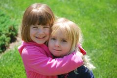 Dont Cry. Two little girls giving hugs Royalty Free Stock Photo