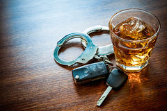 Dont drink and drive. Whiskey with car keys and handcuffs concept for drinking and driving Royalty Free Stock Photos
