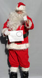 Dont Forget. Santa Claus holds a calendar with Dec. 25 circled and points as if to say, Dont forget you have only xxx number of days before christmas stock photos