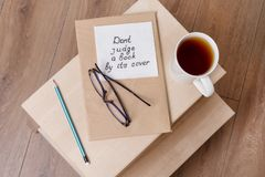Dont judge a book by its cover - a handwritten inscription on a napkin. royalty free stock photos