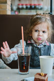Dont like junk food. Kid refuses to drink cola Royalty Free Stock Photography
