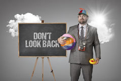 Dont look back text with holiday gear businessman Stock Photos