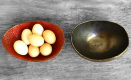 Dont put all eggs in one basket proverb. Representing two trays with eggs not shared Stock Photo