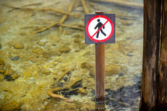 Dont step into the water. Sign outdoors stock image