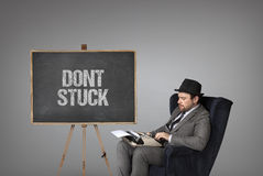 Dont stuck text on  blackboard with businessman Royalty Free Stock Photo