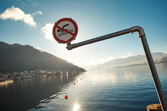Dont swim in winter in Austria with a view of the mountains and the lake royalty free stock image