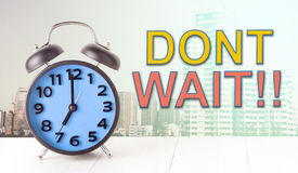Dont wait with clock on city concept Stock Photo