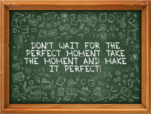 Dont Wait for the Perfect Moment, Take the Moment and Make it Perfect. Green Chalkboard with Hand Drawn Dont Wait for the Perfect Moment, Take the Moment and royalty free illustration
