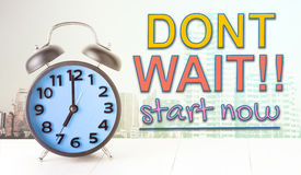 Dont wait start now text with alarm clock Royalty Free Stock Photography
