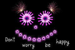 Dont worry be happy message concept. Dont worry be happy message with purple smiling daisies on a black background. Happiness and caring concept Stock Images