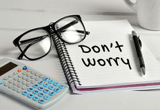 Dont worry word. On notebook page Royalty Free Stock Photo