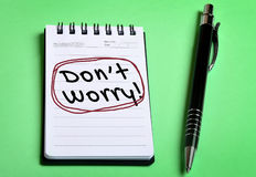 Dont worry word on notebook. Page Royalty Free Stock Photos