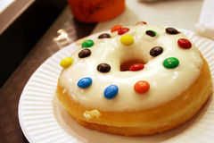 Donut. On white carton dish with sweets on top stock image