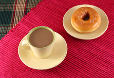 Donut. And coffee on red cloth Royalty Free Stock Photography