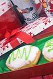 Donut. S raspberry filled bismark in a gift box. Christmas theme Stock Image