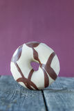 Donut against lilac background. On a rustic wooden background Stock Photos