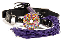 Donut ball gag and whip Stock Images