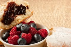 Donut with berries and jam. Healthy food vs. junk food Stock Image
