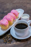 Donut with black coffee Royalty Free Stock Images