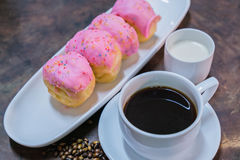 Donut with black coffee Stock Photography