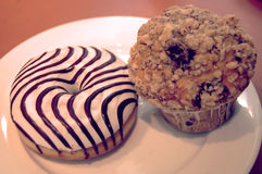 Donut and blueberry muffin - vintage effect. Royalty Free Stock Images