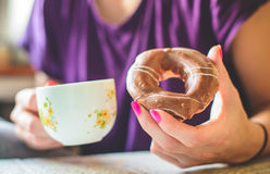 Donut for breakfast Royalty Free Stock Images