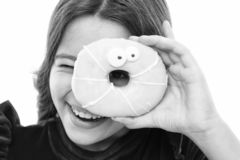 Donut breaking diet concept. Girl hold glazed donut white background. Kid girl hungry for sweet donut. Sugar levels and stock photography