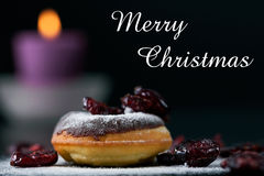 Donut, candle and cranberries - concept Royalty Free Stock Photos