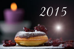 Donut, candle and cranberries - 2015 Stock Image