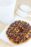 Donut with Caramel, Peanut and Chocolate Topping Royalty Free Stock Images
