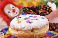 Donut at carnival with clown Stock Photography