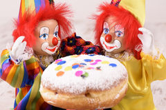 Donut at carnival with clowns Royalty Free Stock Photo
