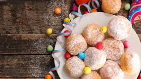 Donut for carnival. On wood Stock Photo