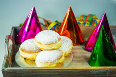 Donut for carnival, New Year`s Eve, colorful hats, streamers Stock Image