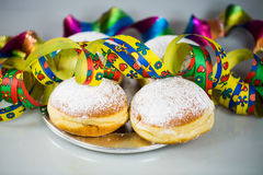 Donut for carnival, New Year`s Eve, colorful hats, streamers Stock Photography