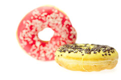 Donut with chocolate and colorful sprinkles Royalty Free Stock Images