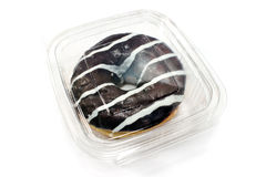 Donut in chocolate glaze in plastic box Royalty Free Stock Image