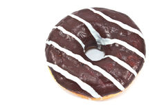 Donut in chocolate glaze with stripes Royalty Free Stock Images