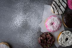 Donut with chocolate glazed and strawberry glazed on concrete table.  royalty free stock images