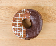 Donut chocolate glazing on wooden background, Assorted Colorful. Royalty Free Stock Photography