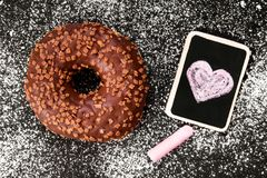 Donut with chocolate and heart drawing,. Copy space stock images