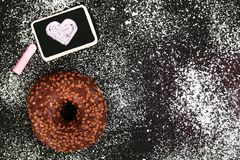 Donut with chocolate and heart drawing,. Copy space stock photo