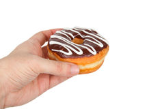 Donut with Chocolate Icing. Hand Holding Donut with Chocolate Icing Isolated on a White Background royalty free stock photography