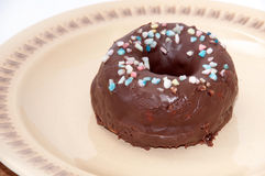A donut with chocolate icing and decoration Royalty Free Stock Photo