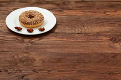 Donut with chocolate icing and nuts Royalty Free Stock Images